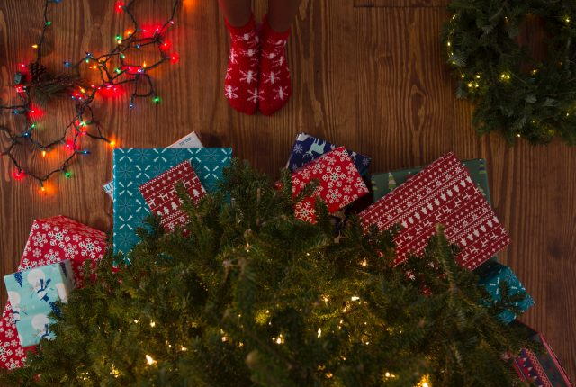 Best Christmas Puns That Will Sleigh The Competition, Presents and lights under Christmas tree